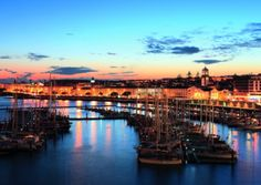 Ponta Delgada, Azores. Find historic charm in this now urbanized port city as the sun sets on the marina.