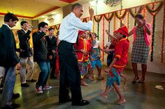 The president dancing with school children and the First Lady in Mumbai, India, Nov 7, 2010 © Pete Souza / Official White House Photo