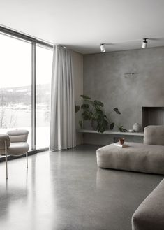 A Cubic Dwelling in #Norway Just Oozes #Hygge - Dwell #concrete #livingroom #scandinavian #minimalist