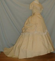 1860's three piece pale yellow ball gown that has recently been de-accessioned from a museum collection.   The fabric is a cotton and gauze blend.  The bodice is trimmed with white silk fringe.