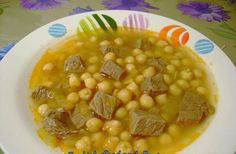 1 lb beef, in chunks 1 onion, chopped 1+1 tbsp canola oil 2 cups chick peas, cooked/canned 3-4 cups water 1 tbsp salt to taste 1 ½ tbsp toma...