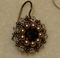 Sidonia's handmade jewelry - Vintage Swarovski beaded earrings--Materials needed: 8mm burgundy Swarovski chatons, codes 1088 oe 1028; 3mm bronze Swarovski pearls; 3mm silver shadow or vintage rose Swarovski bicones; Miyuki 15/0 matte mt dark bronze seed beads - code 2006; Size 12 beading needle; Size B (4LB) Crystal Fireline beading thread.