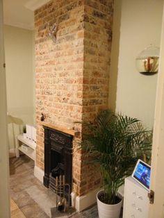 Bare brick chimney breast. Study. Rustic/industrial