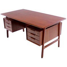 Danish Modern Floating Top Teak Executive Desk Designed by Gunni Omann | From a unique collection of antique and modern desks at https://www.1stdibs.com/furniture/storage-case-pieces/desks/