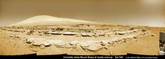 """Mars rock rows and Mount Sharp. Martian landscape scene taken by NASA's Curiosity Mars rover as it paused mid drive at the Junda outcrop. 2014-02-19. Colorized navcam camera photomosaic. UHF Antenna at right. (Credit: NASA/JPL-Caltech/Marco Di Lorenzo/Ken Kremer) Mona Evans, """"Mars Facts for Kids"""" http://www.bellaonline.com/articles/art36393.asp"""