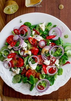 Salad with tomatoe, fetacheese, chili and red onion Caprese Salad, Onion, Chili, Salads, Red, Chile, Onions, Chilis, Salad