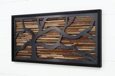 Reclaimed wood wall art made of old barnwood and by CarpenterCraig