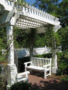 white pergola, seating & picket fence ***Repinned by Normoe, the Backyard Guy (#1 backyardguy on Earth) Follow us on; http://twitter.com/backyardguy