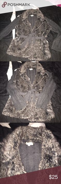 Fur sweater This is a Adorable fur sweater only been worn a few times fur on the front and the back is black sweater material also has a belt that ties around it looks very classy and cute sizeL Joseph Allen Sweaters Cardigans