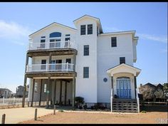 Ever wanted to have a home on the water How about 360 degree view of water This four bedroom four full bath home located in the tranquil 40 home community of  Pond Island Marina offers just that.  Built in 2003 designed with careful consideration for the surroundings. The windows and doors on the third level (Main Living) allow the natural light to flow continuously. The elevation of this level allows views as far a Bodie lighthouse to the south Colington and Jockeys Ridge to the north…