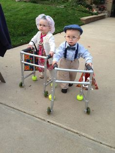 25 Awesome Halloween costumes from 2014. LOVE THE LITTLE TWINS (yes they are twins :) ) in their old people costumes!! TOTALLY doing this if we have a boy and a girl :)
