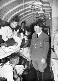 Hitler, victorious in Poland, visits a hospital train en route back home. Hitler's visits to the front became less frequent as the fortunes of war turned against Germany -- until they stopped completely by mid-1944.