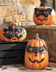Create a festive and enchanting display on your porch this Halloween with the Masked Pumpkin with Leaves; a charming collection with three separate pumpkins boasting their own unique personalities.