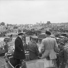 Prime Minister Winston Churchill observes destruction at Caen, France, with General Sir Bernard Montgomery and Lieutenant General Sir Miles Dempsey on 22 July 1944.