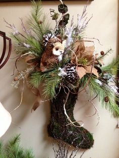 Owl floral arrangement. Would love this arrangement but in an urn instead. Ideas for Christmas through Winter decorating.