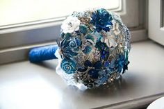 black white silver royal blue wedding | 10-inch blue, white & silver brooch bouquet with a cobalt blue lace ...