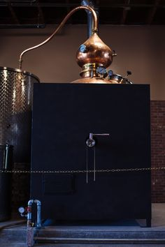 One of our copper pot stills. This is made by Hoga in Spain, hand hammered copper. This shape is like old cognac stills, the black box is our custom made heat box for heat retention.  Sonoma County Distilling Company