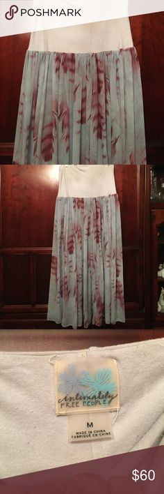 Free People feather  Skirt/ Dress Free People feather  Skirt/ Dress can be worn as both sheer bottom but if you wear slip it is very cute Free People Skirts Maxi