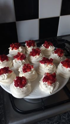 Baby shower afternoon tea - sweet treats. Homemade mini meringue beats filled with whipped cream and chopped strawberries and raspberries to put on top