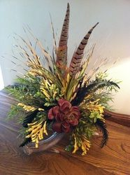 Deer Antler Floral Centerpiece with succulent & feathers.
