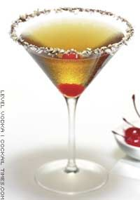 Nutcracker Sweet     Ingredients:  - 1 1/2 oz Level Vodka  - 1/2 oz Amaretto  - 3/4 oz White cream de cacao  - Garnish: Maraschino cherry