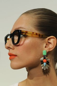 Somehow the earrings, glasses, and lipstick all manage to work. (J.Crew)