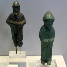 https://flic.kr/p/cVRhfU   Dedications from Berekla   Inv. 13060 & 13057: Figurines of shepherds wearing a hat, cape, and closed shoes. Late 6th-early 5th c. BCE  Miniature bronze votives from the sanctuary of Pan Nomios at Berekla (Neda), Parrhasia, Arkadia, Greece.  National Archaeological Museum Athens, Greece