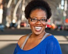05-Location-headshot-of-smiling-black-woman-with-long-afro-on-NYC-street-(Shamara-Loraine).jpg