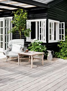 comfy chair and great deck for outside of little house