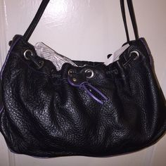 """EUC Cul-De-Sac Pebble Soft Leather Purse Soft pebble black leather with purple trim. Small but fits a lot :) Measures: 6"""" high, 12"""" long, 5.5"""" wide. Straps drop: 11"""". In excellent used condition. Bags"""
