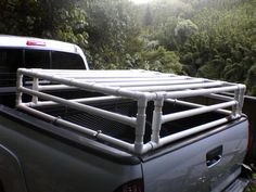 Truck bed cage for dogs out of pvc. Great idea...it makes me nervous seeing dogs free in a truck bed