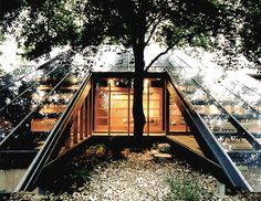 Rejecting the widely-held belief at the time, that low-energy and ecologically responsive design was intrinsically shaped by an anti-industrial aesthetic, Herzog embraced the convergence of science, modernism, and innovation to generate sustainable architectural solutions.  For example, the 'sunspace' concept has been in practice since the Victorian era, when conservatories were built at exterior walls as transitional spaces, used to moderate the temperature between interior spaces and the…
