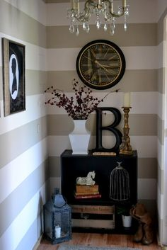 Stripes for bedroom accent wall.... collage walls are so elegant for back entry ways