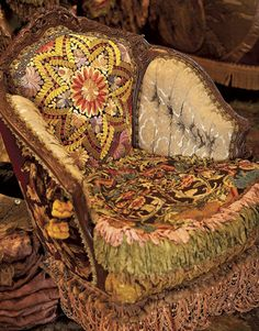 Freaking amazing antique chair upholstered with vintage fabrics, quilt, and fringe