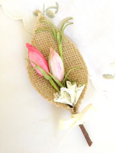 Burlap Boutonniere.  Might work for a farm wedding