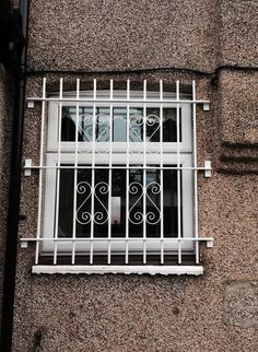 delighted client with our rsg2000 window security bars fitted to his house in greenford middlesex