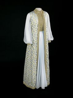 Rosalynn Carter's Inaugural Gown, 1977    Rosalynn Carter wore this gold-embroidered sleeveless coat over a gold-trimmed blue chiffon gown to the 1977 inaugural balls. It was designed by Mary Matise for Jimmae and purchased through Jason's in Americus, Georgia. Mrs. Carter's decision to wear the same dress that she had worn to the 1971 ball celebrating her husband's inauguration as governor of Georgia raised questions.
