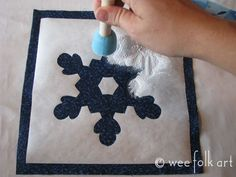 Freezer Paper Snowflake Stencil | Wee Folk Art. Gives a crisp line because it sticks well when ironed to fabric.