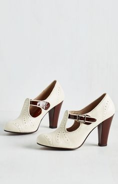 Retro heels and the color is , classy and gorgeous. Another classic investment, versatile. Take to polish the heels and buff the winter white too shoe fabric .  Enjoy !