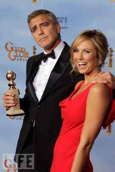 Hm, I Guess Life Isn't So Bad ...  Best Actor in a Motion Picture Drama winner George Clooney and Stacy Keibler pose in the press room.  In this photo: George Clooney, Stacy Keibler  Photo: Jeff Vespa/WireImage  Jan 15, 2012