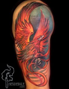 Very active image phoenix tattoo on the upper arm.
