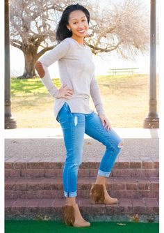 This look is so chic, and will look great for any body type. The mocha elbow patch sweater is worn with a distressed boyfriend style cropped jeans and fringe bootie.