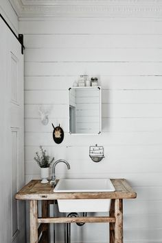 Bathroom makeover ideas of white walls paired with rustic wood to transform mine into the perfect scandi boho bathroom! Take a look at part 1...