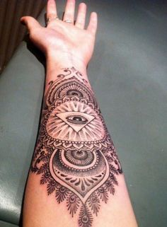 Symbol of Illuminati mandala and eye forearm tattoo