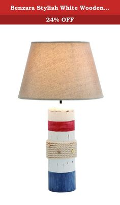 Benzara Stylish White Wooden Buoy Table Lamp with Red and Blue Band. Features: It comes with an ivory colored lamp shade It is suitable for any home It is elegantly designed Description: This beautiful can be placed in your living room or on the bedside table in your bedroom. The wood buoy table lamp is accented by a red and blue band which adds to the beauty of the lamp. It comes along with an ivory colored lamp shade that diffuses the light and gives the room a welcoming ambience. It...