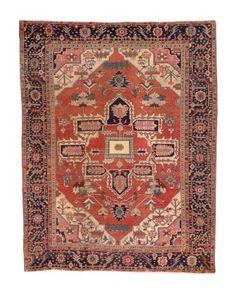HERIZ CARPET  NORTHWEST PERSIA, CIRCA 1875  Approximately 12 ft. 9 in. x 10 ft. (389 cm. x 305 cm.)