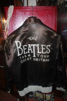 Vintage ORIGINAL The Beatles 1964 Tour Satin Bomber Jacket with Embroidered Lettering. $975.00, via Etsy.