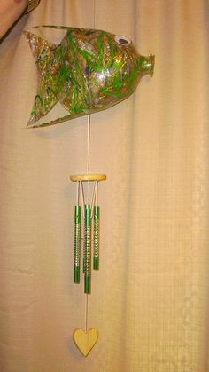 Plastic Coke bottle wind chime fish.