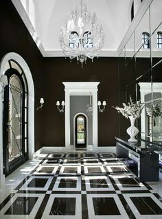 Agatha O l This mesmerizing black and white hallway was completed by Salcito Custom Homes. Black And White Hallway, Black And White Interior, Black White, Black Walls, Black And White Flooring, White Style, White House Interior, Black And White Furniture, Monochrome Interior