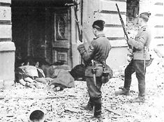 """Ukrainian SS volunteers in the Warsaw uprising in April 1943. A battalion of """"Askari"""" - Ukrainian and Latvian volunteers, 337 men strong - had been brought in by the Germans to help storm the ghetto."""